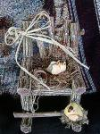 View details for this Goldfinch nesting in Rocking Chair Figurine